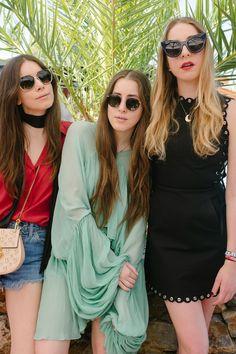 Danielle Haim in Levi's shorts and Drew bag, Alana Haim in a Chloé top, and Este Haim in Karen Walker Eyewear sunglasses