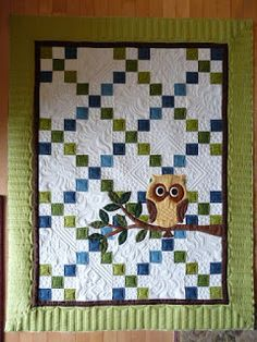 This is a fiercely cute baby quilt one of my clients made. She always does impeccable applique, all by hand. I had fun with the white ...