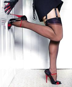 Black suspenders with black nylon stockings and red and black heels.