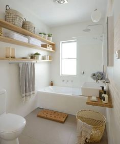 18 light-colored wooden box and open shelving add a warm touch to the bathroom - DigsDigs