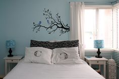 blue bedroom - such a sweet stencil idea over the bed.  Of course, I love the color combo.