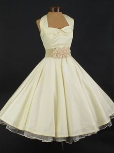"Our house brand 1950s inspired ""Uptown Doll"" tea length wedding dress done in a luxe ivory cotton sateen fabric. A classic retro look for your informal vintage themed wedding. Also makes a lovely reception dress or going away dress."