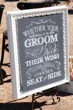 Choose a seat not a side wedding chalkboard style sign. Image: Caitlin O'Reilly Photography
