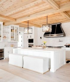 This large open concept kitchen update includes different door treatments on upper and lower cabinetry.