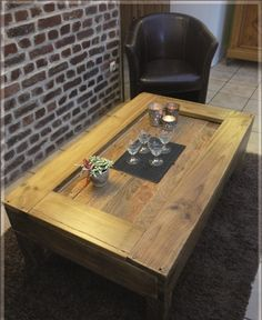 The Dakota. Custom (made to order) Light Stained Coffee Table. Made of reclaimed pallet wood. Free Shipping.. $295.00, via Etsy.