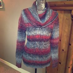 Kensie sweater size M Kensie sweater size M. Very stylish sweater for the winter weather! Cowl neck with a slim fit throughout. It really looks amazing on. Dress up or down in this sweater. You won't be disappointed! Kensie Sweaters Cowl & Turtlenecks