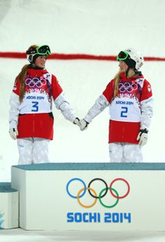 Freestyle Skiing - Winter Olympics Day 1 - SOCHI, RUSSIA - FEBRUARY 08: (L-R) Silver medalist Chloe Dufour-Lapointe of Canada and gold medalist Justine Dufour-Lapointe of Canada congratulate each other during the flower ceremony following the Ladies' Moguls Final 3 on day one of the Sochi 2014 Winter Olympics at Rosa Khutor Extreme Park on February 8, 2014 in Sochi, Russia. (Photo by Mike Ehrmann/Getty Images)
