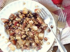 A hearty and healthy breakfast of spiced beaked pears and raisins topped with oats and pecans.