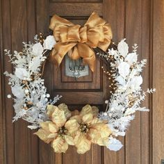 This holiday season enjoy the magic of a white Christmas with this beautiful and elegant wreath. This wreath is a unique combination of snow frosted foliage on a grapevine wreath, complemented with two beautiful light bronze poinsettias with glittery golden accents and a bronze shimmery bow for that holiday sparkle. Measures approximately 20 across. Note: If you see something you like, but would prefer different colors or sizes, remember that custom orders are always welcome. Please contact…