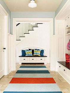 Love how the Bench seat in the foyer sets a landing from the mud room and anchors the foyer instead of the traditional chest or round table