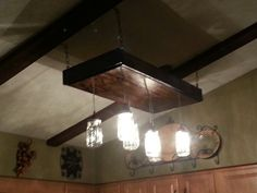New light fixture made out of reclaimed pallets and old mason jars.