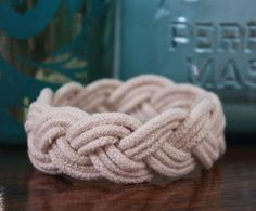 This easy bracelet will add a chic nautical twist to any outfit, especially in the summer. Plus, the sailor's knot bracelet has a rich history. According to Stacy of Flights of Delight, sailors would pass the time by tying knots in spare bits of rope, but eventually they served as good luck charms for sailors and loved ones.
