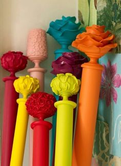 Paint curtain rods in these adorable colors for a pop in a neutral room. Genius !