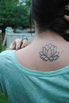 """this is my lotus flower tattoo, got it done at dark star in massachusetts and i couldn't be more happy with how it came out."""