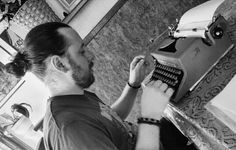 Writer writing typewriter b&w