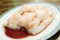 """RICE NOODLE ROLLS (腸粉), found via Buzzfeed - """"Large, thin, usually handmade steamed rice noodle rolled around a tender shrimp or meat center or a crispy nonmeat filling made out of some sort of fried dough, like youtiao (long, unsweetened Chinese cruller)....Sweet soy sauce or a savory sauce is poured over the dish just before it is cut and served."""""""