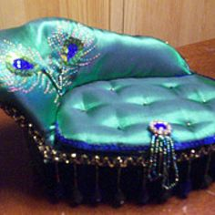 Peacock Sofa! Omg a must have in my living room!