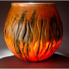 Very Illuminating.  This Norfolk pine vessel is made by Big Island craftsman Ralph Michaelis.  Ralph has perfected the art of translucent wood.  Only at www.MartinandMacarthur.com