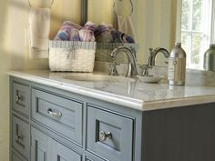 Bathroom: marble w/ slate blue cabinet