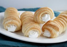 Puff Pastry Horns (aka Italian Cream Horns) are scrumptious puff pastries wrapped around a metal horn and baked till golden and flaky. These little five ingredient wonders can be filled with whipped cream, custard or buttercream icing.