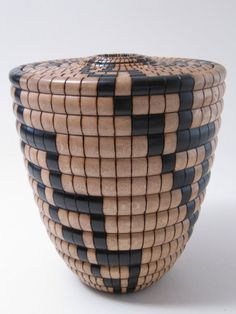 """J. Kelly Dunn ~  'In the Land of Hopi', 2011 ~ 7.25""""H x 6.5""""W  ~ Hopi-styled basket featuring Pink Tecoma."""