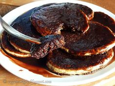 Whole Wheat Orange Pancakes with Chocolate Sauce - light, fluffy, spongy, flavourful and addictive. Easy to make, no egg replacers needed. Get messy and enjoy! << Vegan Magic