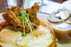 One of our top brunch picks: Hubble & Hudson's glorious chicken and waffle with two eggs and maple-butter sauce.