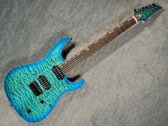"David Thomas McNaught Guitars DJ+ finished in "" Ocean Blue Burst""."