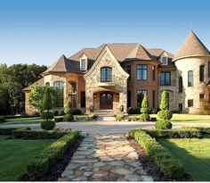 Light brick possible limestone stucco eek dark roof for Beautiful rich houses