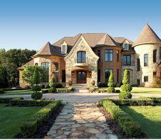 Light brick possible limestone stucco eek dark roof for Beautiful rich houses