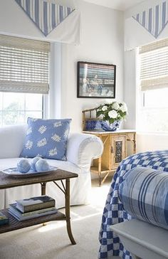 Blue and white patterned accents in a bright white beach house room