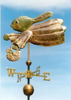 Whimsical Bunny Weather Vane  by West Coast Weather Vanes.  This bunny weathervane can be place on a roof top, garden, or inside a house.