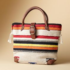 """$248. TIMPANOGOS TRAVEL BAG--Named after a majestic mountain, our bag big enough for a weekend combines serape-striped wool with a wool fabric bottom, handles and buckled closure. Nylon lining with two full-length zip pockets. Made in the USA. 19""""W x 6""""D x 13""""H."""