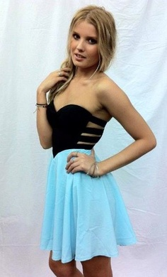 Love the dress. The cut out design, the black sweetheart neck line, and of course the color!