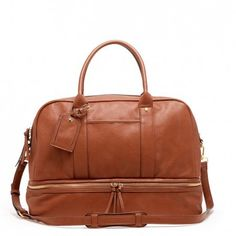Roomy cognac travel bag with a zippered shoe compartment and removable crossbody strap. Great for weekend trips.