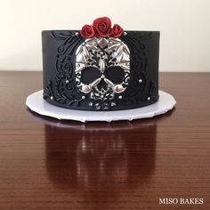 Day of the Dead Skull Cake. Testing boundaries and pushing limits :) Silver leaf skull, sugarpaste roses, royal icing piping, and dragee patterns. Special thanks to @fayecahillcakedesign and Rebecca for the dragees! Must buy more! Please dont look too closely at the piping-- I eyeballed and made up the design as I went! Will share on FB tomorrow! :) #misobakes #skullcake #dayofdead #cake #halloween #skull #royalicing #piping #blackfondant