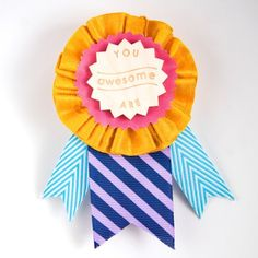 Your fabulous friends need to show the world how awesome they are! Tell them so with a You Are Awesome prize ribbon from Little Bright Studio. The Awesome award features an engraved laser-cut wood chip laying on pieces of yellow, pink, purple and blue ribbons. A pin is securely fastened on the back. A small Certificate of Awesome is included with its own pretty envelope. Now you can make it all official. :)