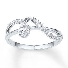 This eye-catching ring for her features a curlicue of diamonds looping around a smooth strip of 10K white gold. Playful and modern, the ring has a total diamond weight of 1/10 carat. Diamond Total Carat Weight may range from .085 - .11 carats.