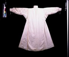 Smocks were made of linen and usually undecorated, so that they could be washed. Wealthy women would own several dozens of smocks and wear a clean one each day. Seams were hand-sewn with a very fine needle and fine linen thread. Smock is made from a single length of fine linen. The pieces, sleeves, collars, cuffs, gussets, are cut in rectangular or square shapes. The gores are made from rectangles cut in half diagonally. By constructing the smock this way, not a single scrap of linen was…