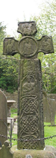 The 8th-9th century Saxon Cross in the 'plague' village of Eyam's, St Lawrence Church graveyard, Derbyshire, England