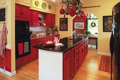 Love the red cabinets with the black countertops!
