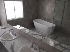 Bathroom example with a beautiful stand alone bath