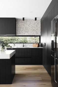 Dark joinery and pops of terrazzo steal the show in this modern home makeover. Terrazzo splashback in kitchen, window splashback in kitchen, black and white kitchen, modern kitchen, built in ovens in kitchen Black Kitchens, Home Kitchens, Kitchen Black, Modern Kitchens, Kitchen Modern, Modern Homes, Home Interior, Interior Design Kitchen, Modern Kitchen Designs