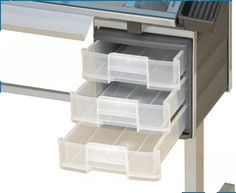 """Studio Designs Vision Craft Station ( Silver/Blue Glass) 10053 by Studio Designs. $177.27. Overall Dimensions: 40""""W x 26""""D x 30.75""""H. Tempered Blue Safety Glass. 3 Plastic Molded Slide out Drawers for Storage. Main Surface: 35.5"""" W x 24""""D. Top Angle Adjustment up to 70 Degrees. # Can be used as a Light Table # Heavy Gage Powder Coated Steel Construction for Durability # 23.75""""W x 2""""D Storage Pencil Ledge # Casters for Mobility with 2 Locking # Two Removable Side ..."""