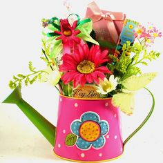 It's a Garden Party  We have filled this cheerful watering can planter with glittery butterflies, flowers and delicious snacks and sweets This fun and very colorfulGarden Party Gift Basket   offers a charming, hand painted watering can with raised flowers; perfect for that special gardening guru This colorful watering can makes a wonderful spring planter Perfect for so many occasions, birthday, friendship celebaration, mother's day, thank you, thinking of you a