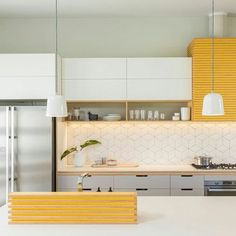 Styling with #yellow definitely brightens this #kitchen  #KitchenDesigns #luxury  For more information about how you can achieve this design contact us at info@pandaygroup.com for all your luxury design needs.   #Toronto #Canada #InteriorDesign #Architecture #Homes #HomeDecor #Design #Modern #Kitchen #Lighting #Bathroom #inspiration #InteriorDesigner #Beauty #Fashion #Travel #ShopOnline #HomeDesign
