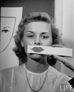 Trying on new lipsticks in 1945 (they ought to make one that shows how you would look with your face all stretched out from having so many face lifts)