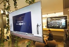 Samsung Electronics' smart TVs are displayed at a store in Seoul July 6, 2012. Soaraway sales of the Galaxy smartphone drove record quarterly profit of $5.9 billion at Samsung Electronics, though the South Korean tech giant is sweating over how Europe's debt crisis is denting demand in its biggest market for televisions and home appliances.