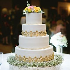 Gold Motif Wedding Cake -- I already have my cake picked out and ordered, just wanted more color inspiration and I think gold beads will looks nice.
