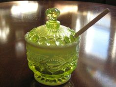 """Vaseline Opalescent Glass Eyewinker Pattern Honey Pot with Lid & Wooden Dipper by Mosser Glass. $32.40. Great gift. Part of a large set available now. Measures 5"""" tall and 4"""" wide. Made in Ohio. Made with Uranium. Footed and elegant. This piece matches the entire line we carry. The Eyewinker pattern is an old LG Wright Glass Co mould. Hand made in Ohio. Save 54% Off!"""